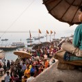 At noon ghats are already vibrant with life: people are praying, working, begging or simply resting.