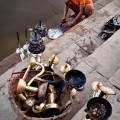 ...boys cleaning ritual utensils after the yesterday's evening puja...